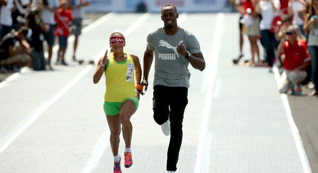 Usain Bolt guía a la campeona del mundo ciega
